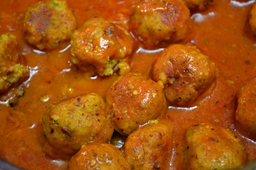 lentil kofta in madras curry sauce